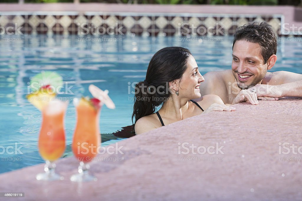 Hispanic couple in swimming pool royalty-free stock photo