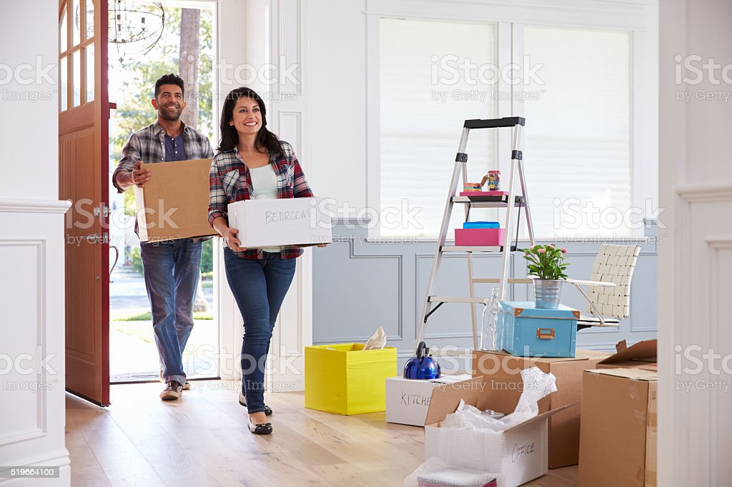 Hispanic Couple Moving Into New Home Together stock photo