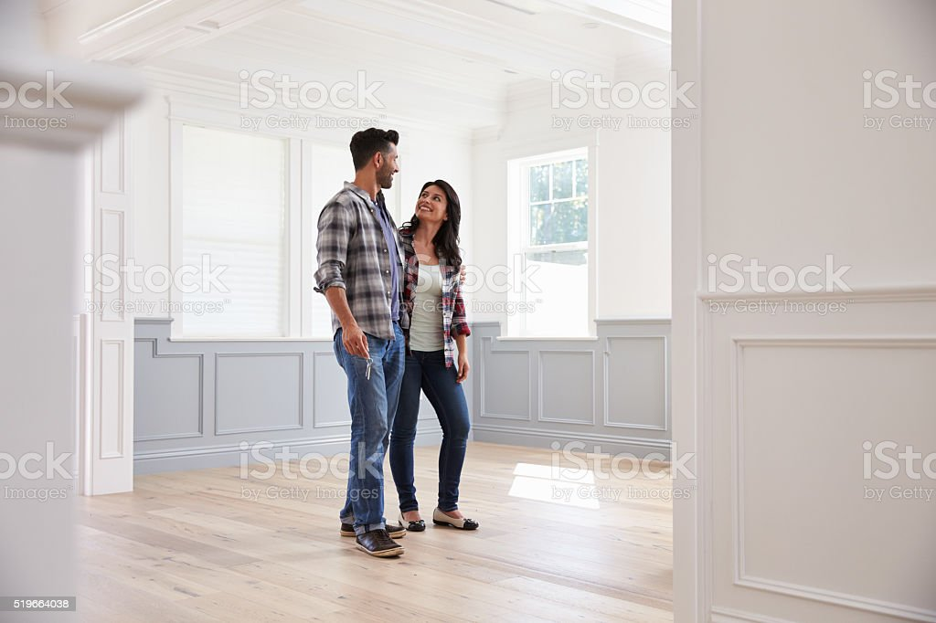 Hispanic Couple Viewing Potential New Home stock photo