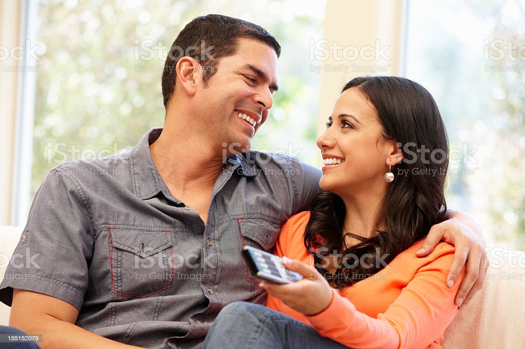 Hispanic couple watching television royalty-free stock photo