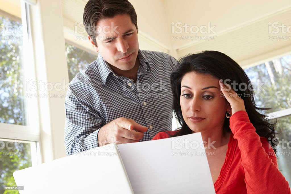 Hispanic Couple Working In Home Office royalty-free stock photo