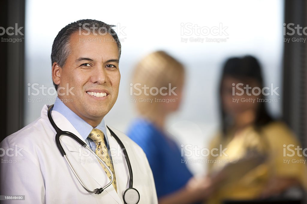 Hispanic Doctor Smiling In The Office royalty-free stock photo