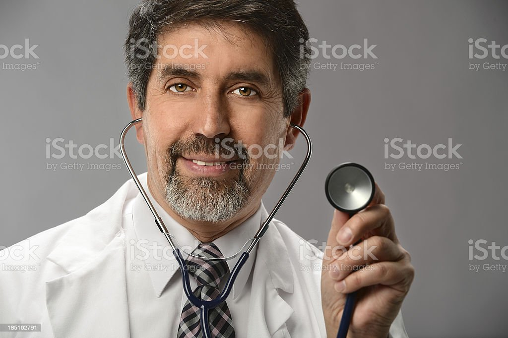 Hispanic Doctor Using Stethoscope royalty-free stock photo