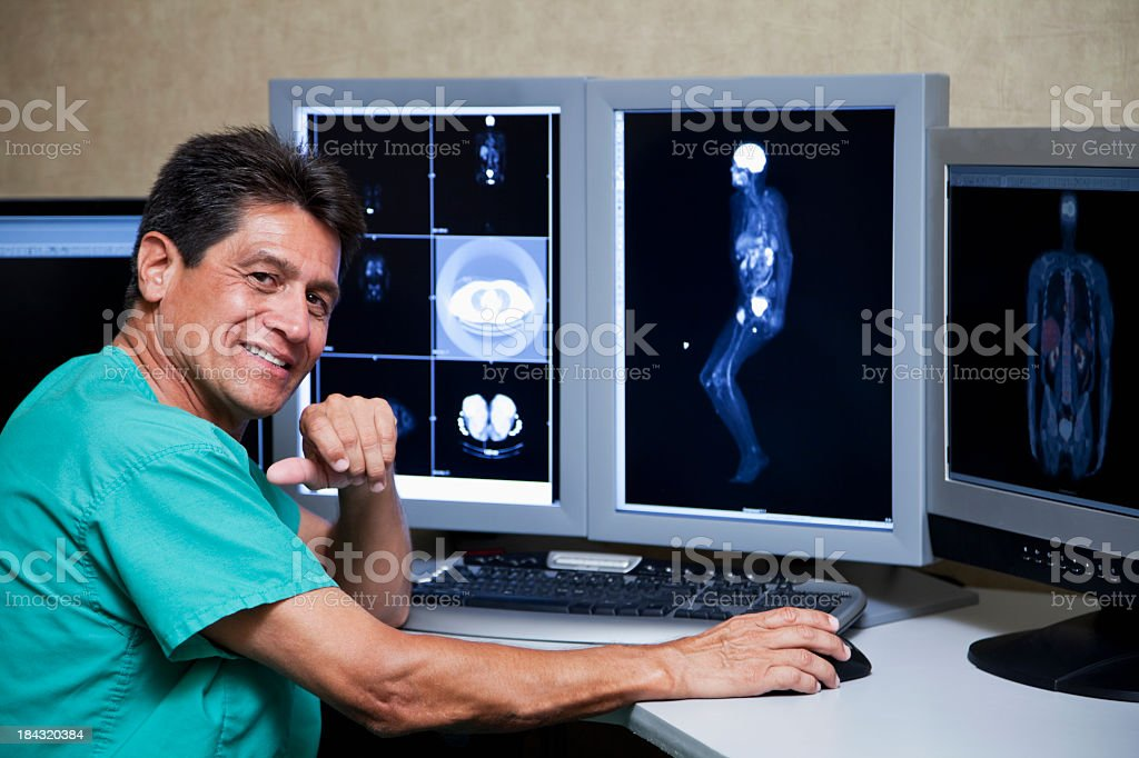 Hispanic doctor with medical scans royalty-free stock photo