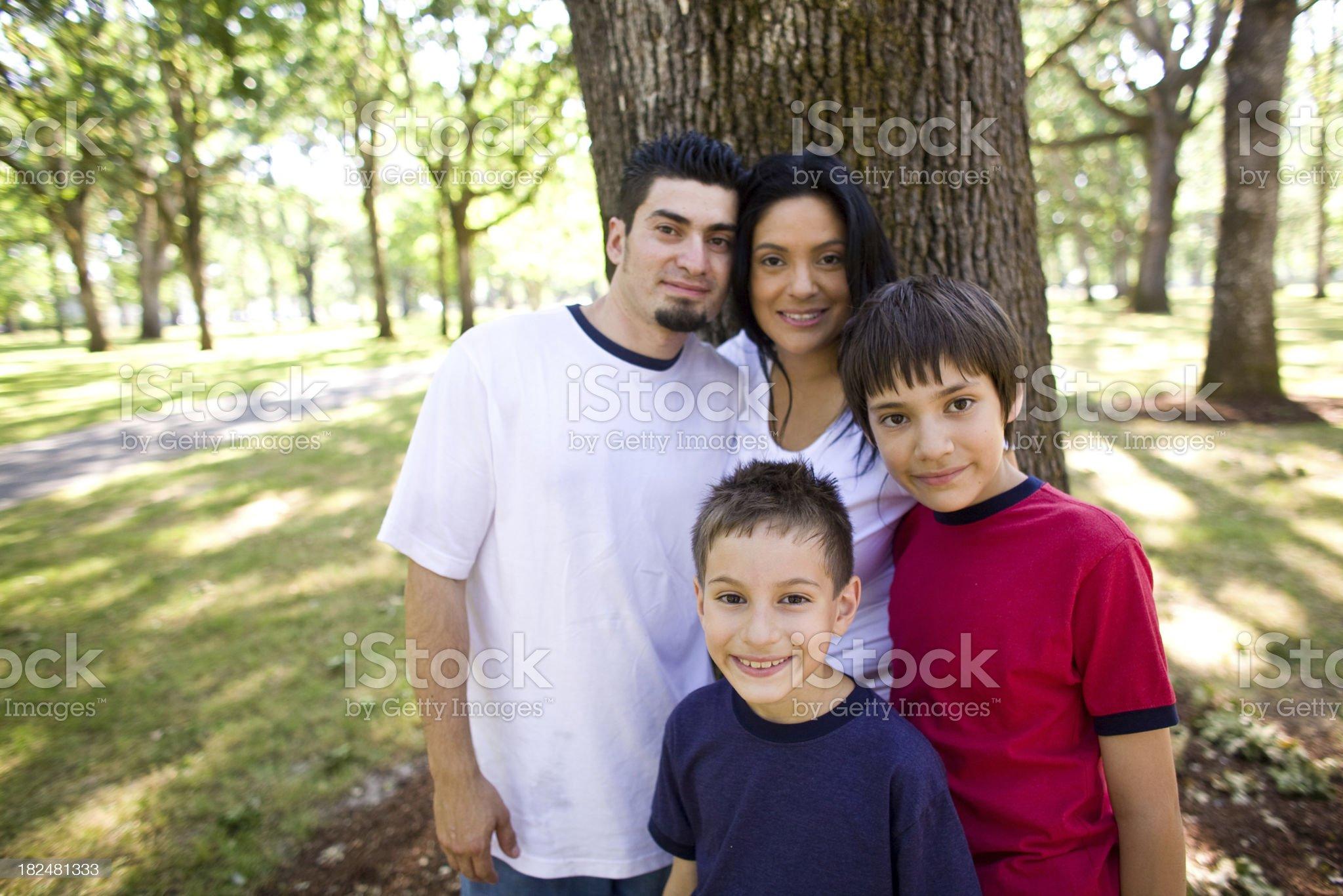 hispanic family at a park royalty-free stock photo