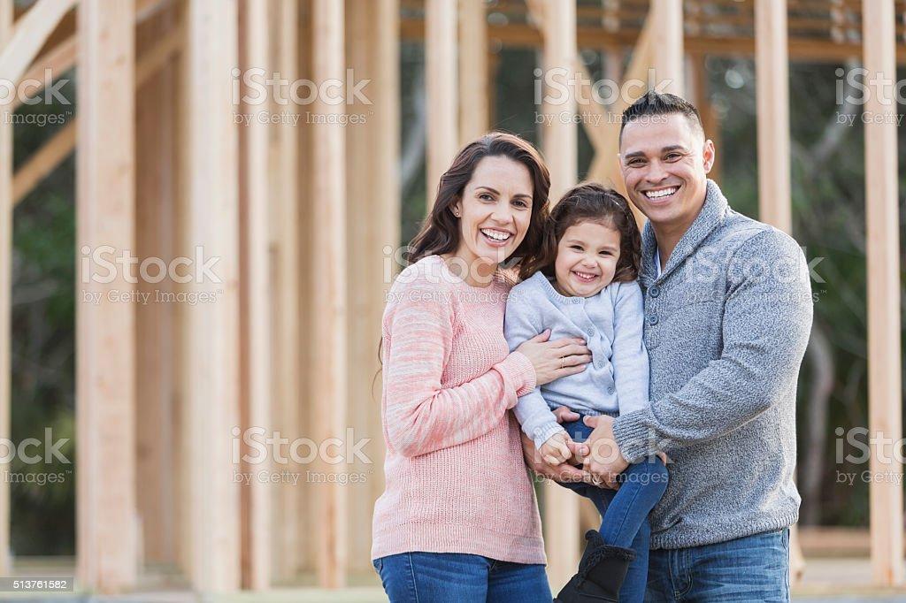 Hispanic family building a new home stock photo