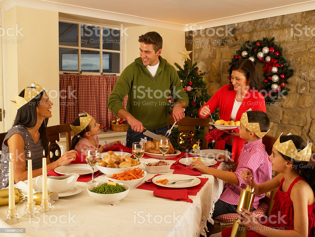 A Hispanic family enjoying a nice Christmas dinner royalty-free stock photo