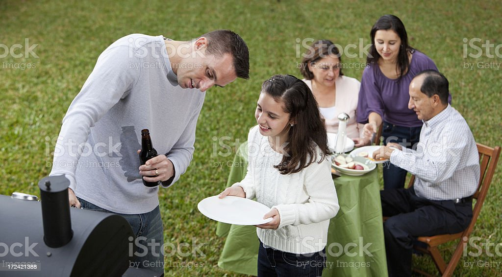 Hispanic family having cookout stock photo