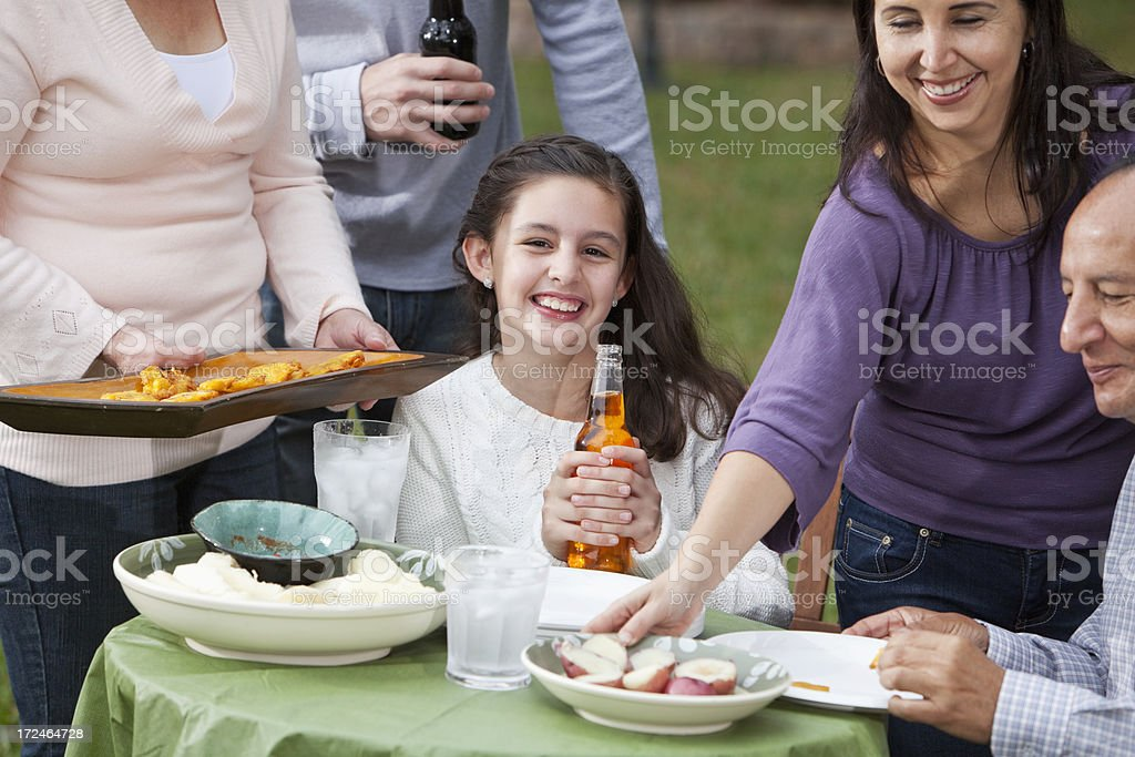 Hispanic family having cookout stock photo