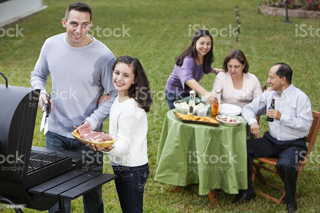 Hispanic family having cookout royalty-free stock photo