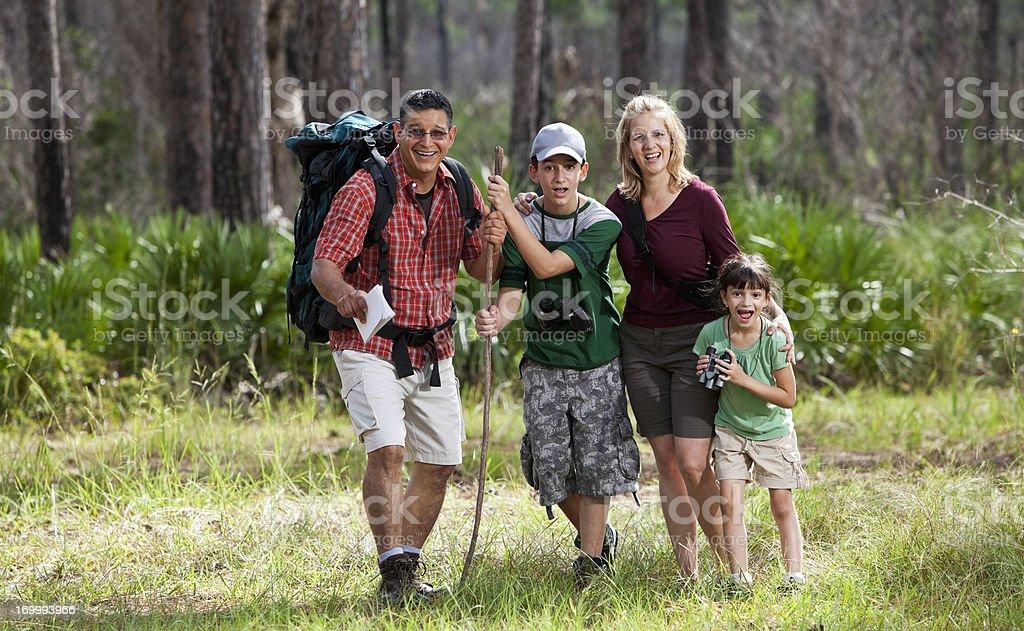 Hispanic family hiking in woods stock photo
