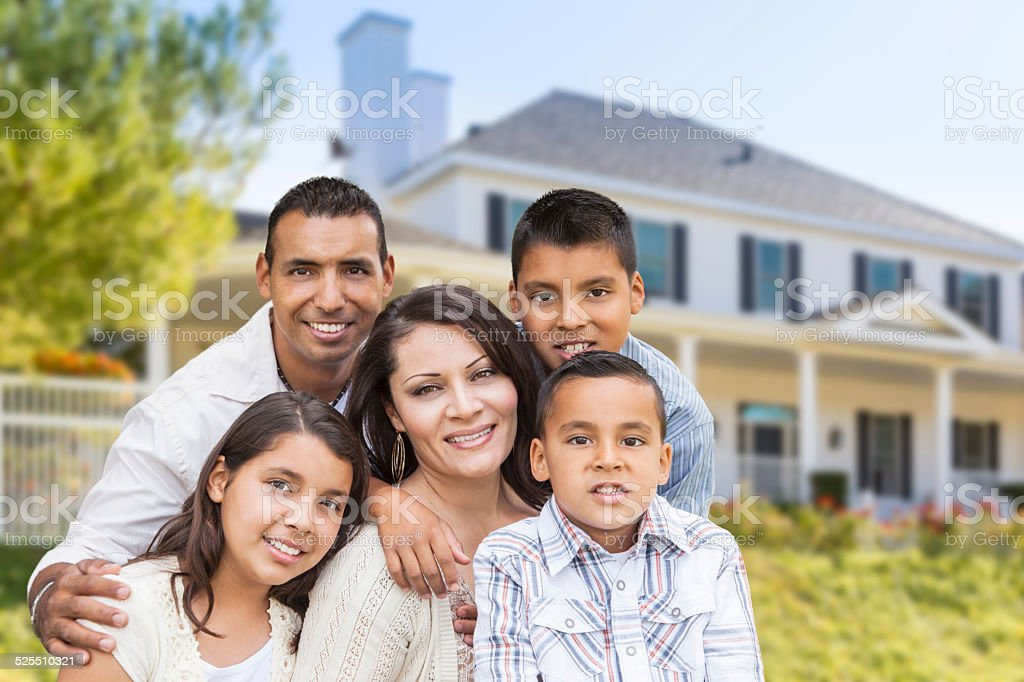 Hispanic Family in Front of Beautiful House stock photo