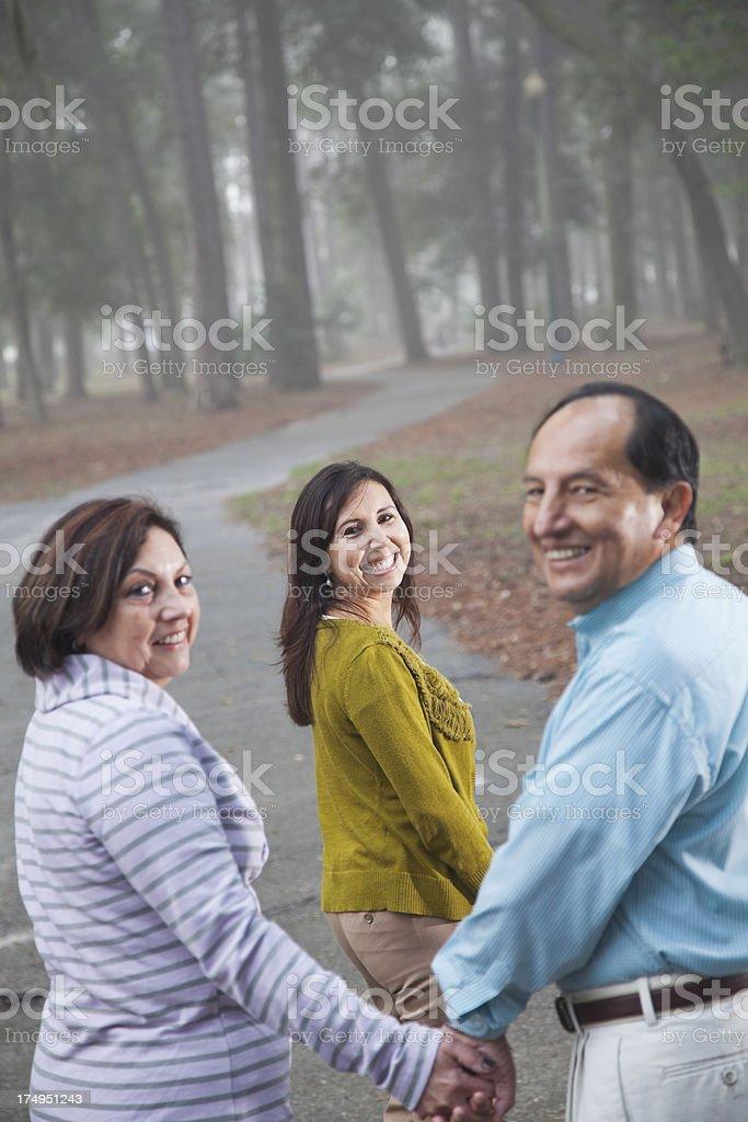 Hispanic family in park royalty-free stock photo