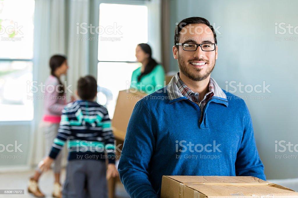 Hispanic family moves into new home stock photo