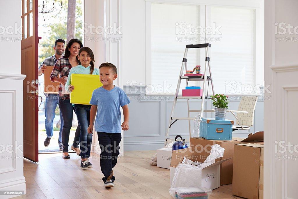 Hispanic Family Moving Into New Home stock photo