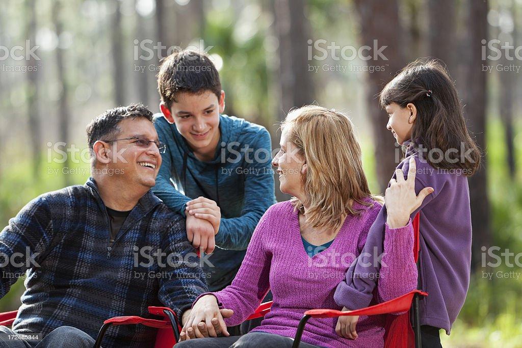 Hispanic family outdoors stock photo