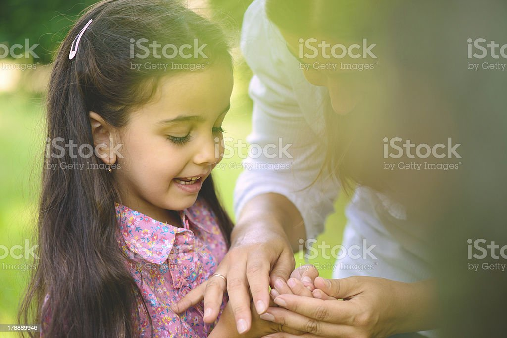 Hispanic family playing in sunny park royalty-free stock photo