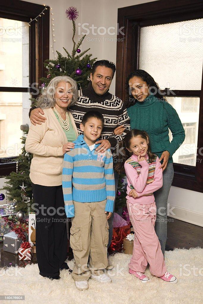hispanic family portrait at christmas time stock photo