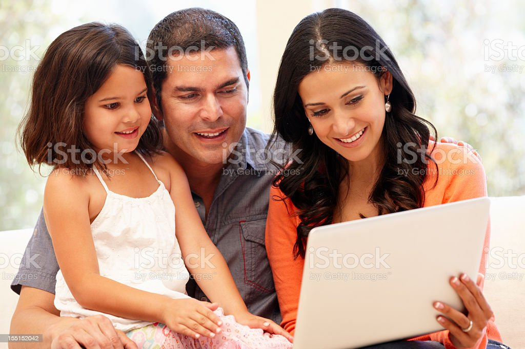 Hispanic family with laptop at home royalty-free stock photo