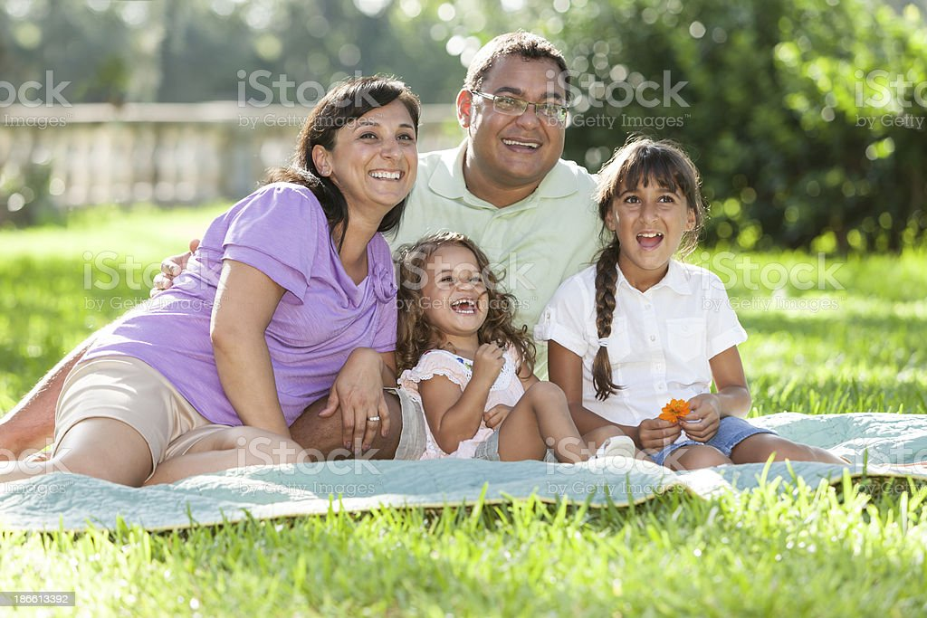 Hispanic family with two girls royalty-free stock photo