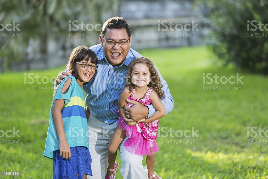 Hispanic father and daughters royalty-free stock photo