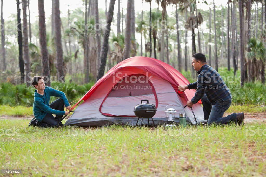 Hispanic father and son, camping stock photo