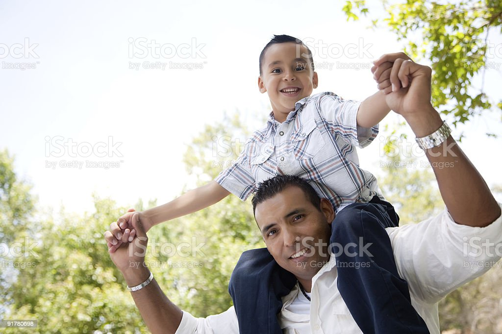 Hispanic Father and Son Having Fun in the Park stock photo