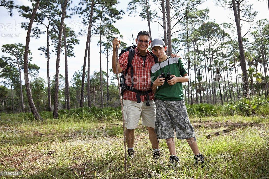 Hispanic father and son hiking. stock photo