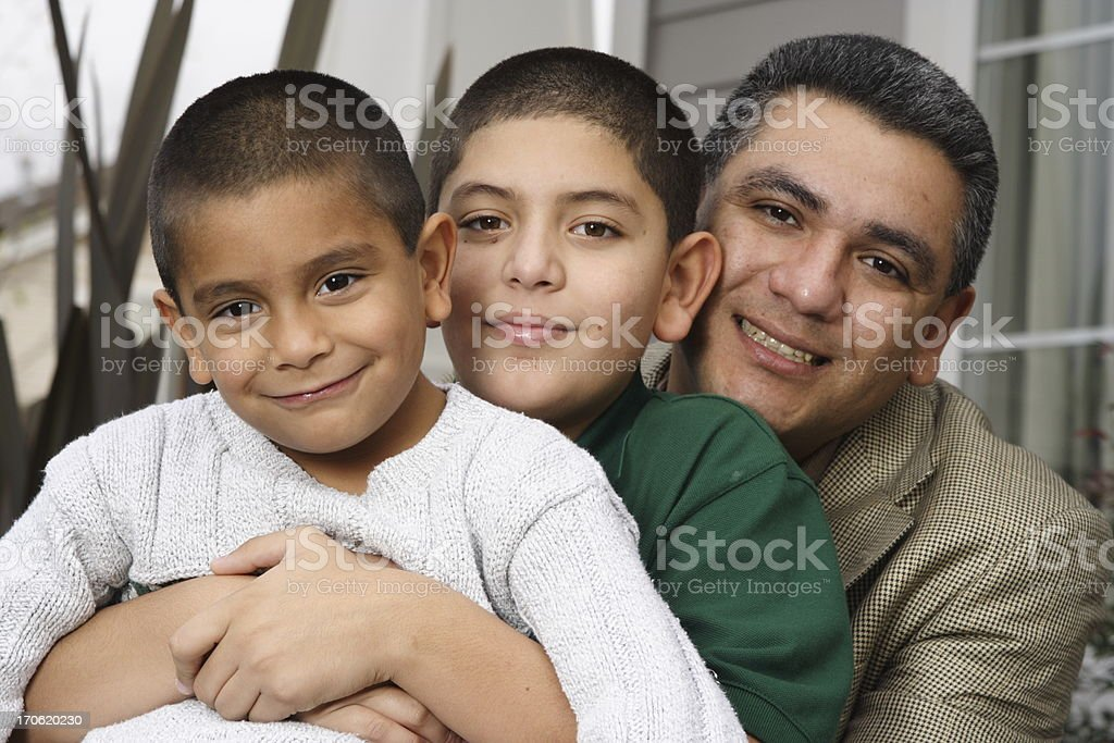 hispanic father and sons in front of house royalty-free stock photo