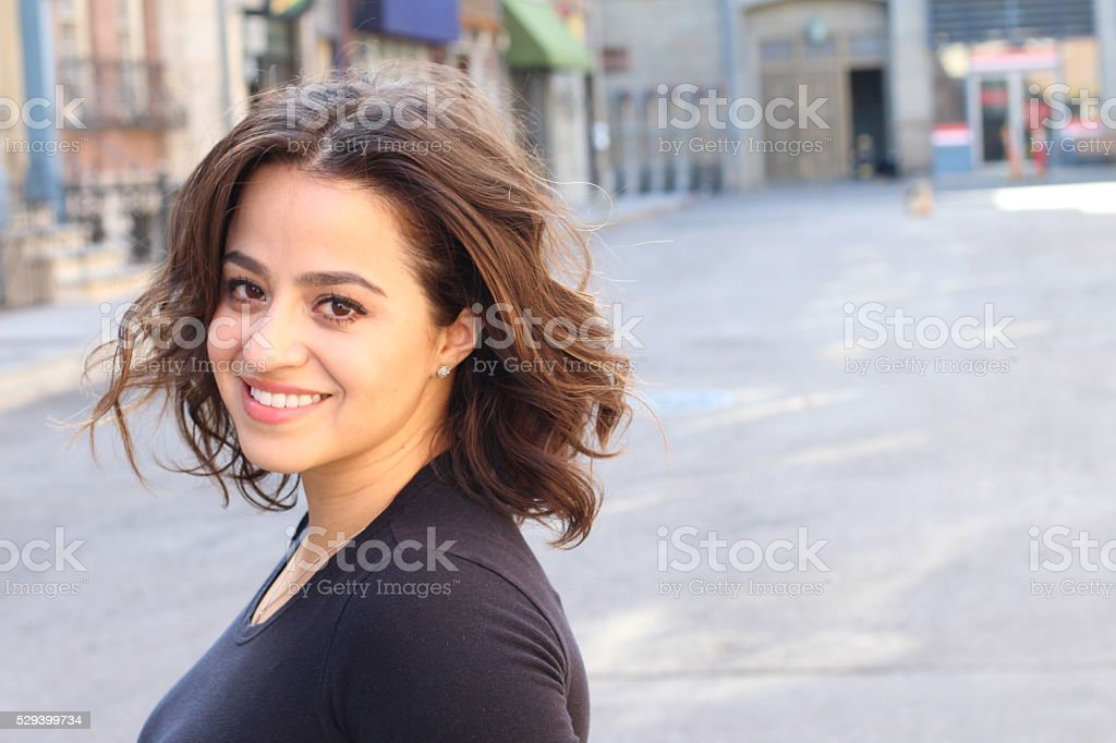 Hispanic female smiling with copy space stock photo