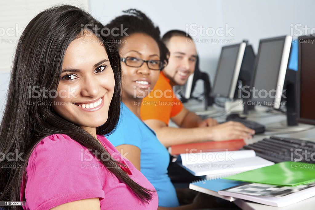 Hispanic Female Student in Class With Other Students royalty-free stock photo