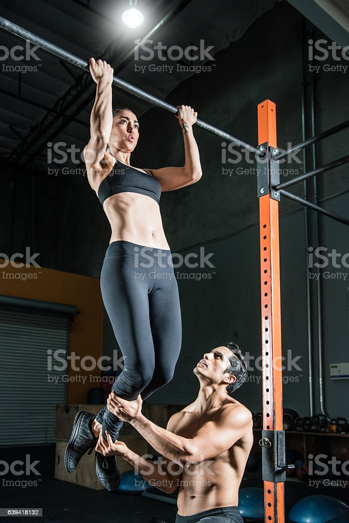 Hispanic Fitness Couple Working Out Together stock photo