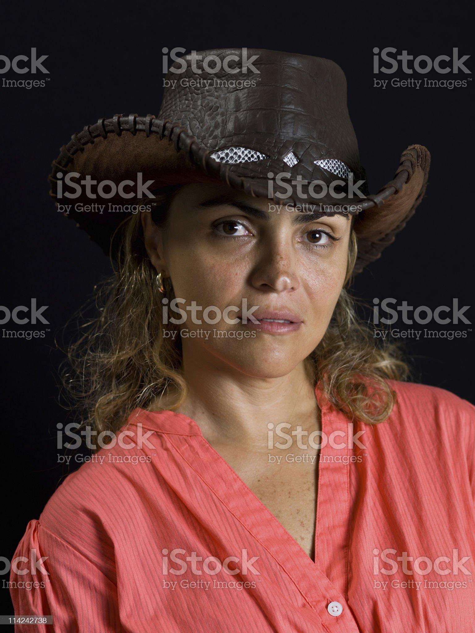 Hispanic forty something cowgirl (no makeup) royalty-free stock photo