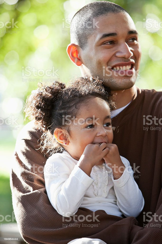 Hispanic girl in daddy's arms stock photo