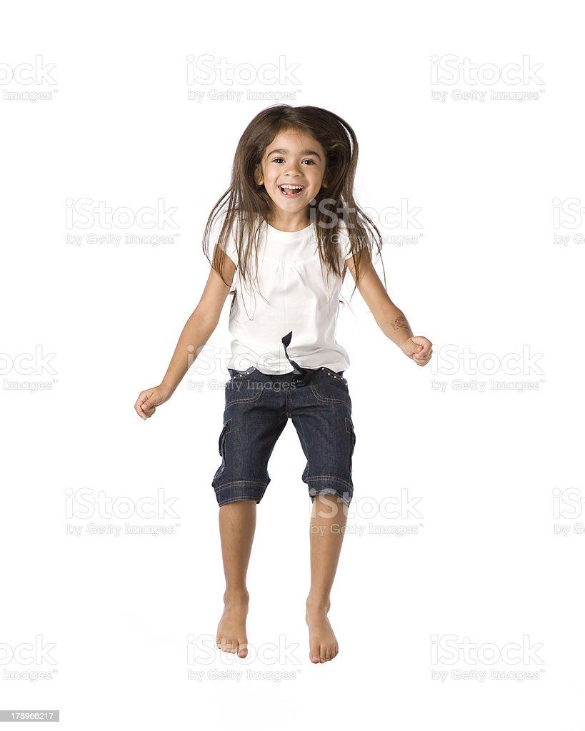 Hispanic Girl Jumps in Air royalty-free stock photo