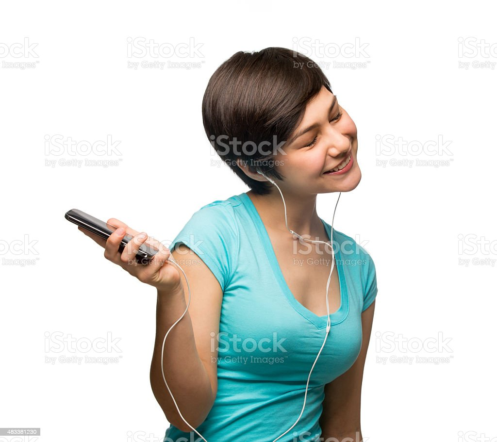 Hispanic girl listening music stock photo