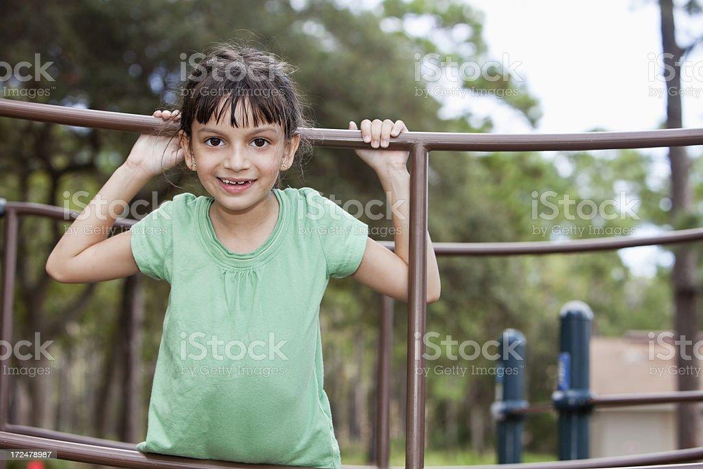 Hispanic girl playing on playground stock photo