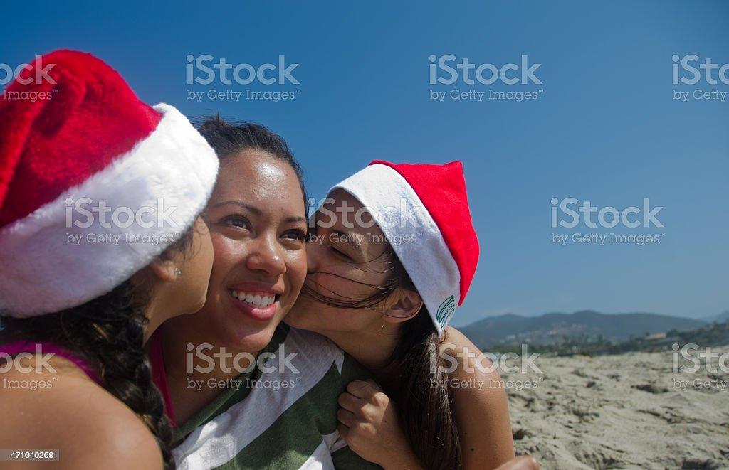 Hispanic Girls Christmas on the Beach royalty-free stock photo