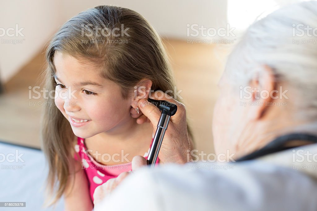Hispanic Girl's Pediatrician Visit, Ears stock photo