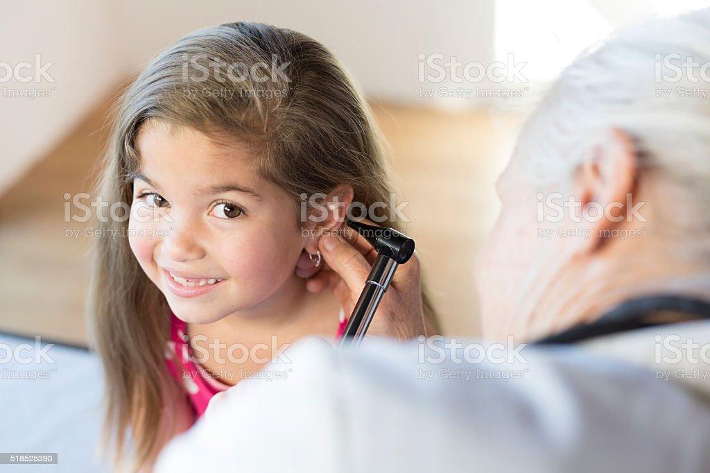 Hispanic Girl's Pediatrician Visit, Ears stock photo