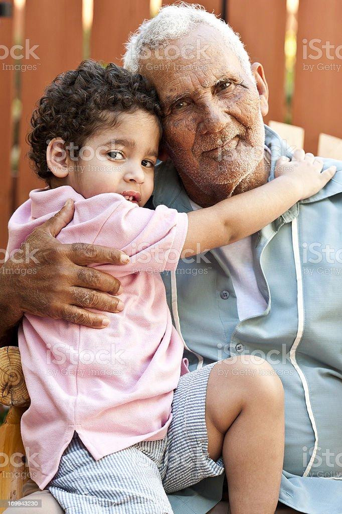 Hispanic grandfather with his grandson royalty-free stock photo