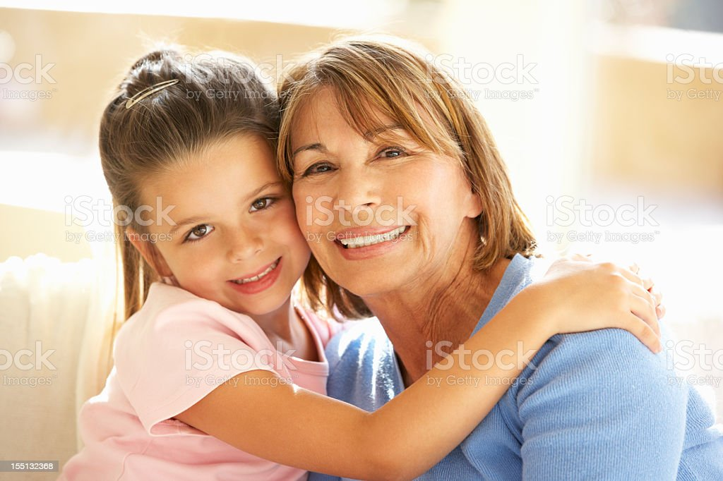 Hispanic Grandmother And Granddaughter Relaxing At Home royalty-free stock photo