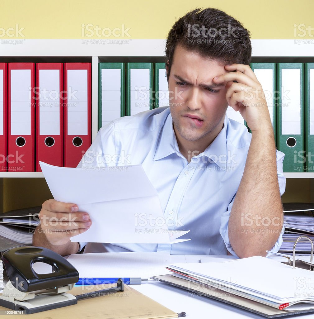 Hispanic guy with problems at office stock photo