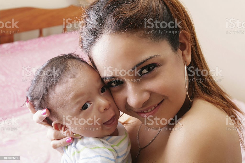 hispanic happy young mother holding a baby royalty-free stock photo