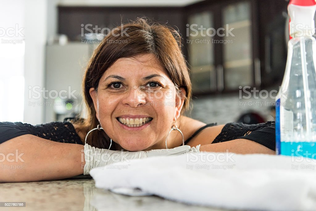 Hispanic housewife posing at her kitchen stock photo