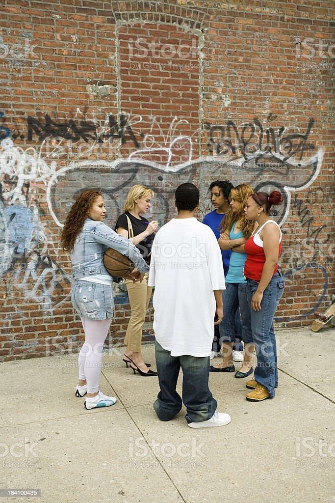 Hispanic kids meeting with a female social worker royalty-free stock photo