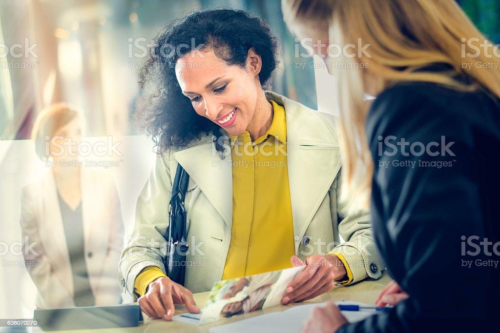 Hispanic lady at an insurance agency counter stock photo