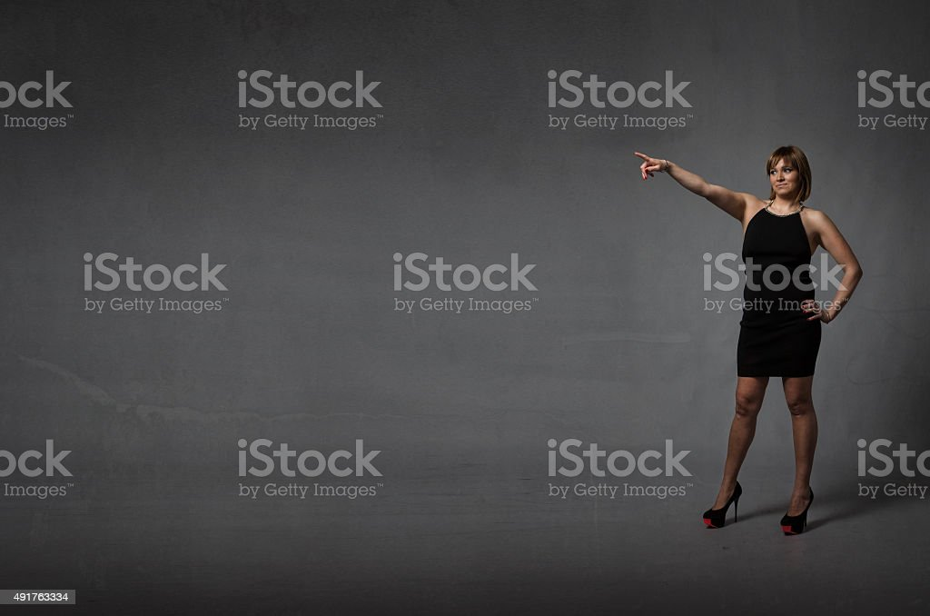 hispanic lady indicated with finger up stock photo