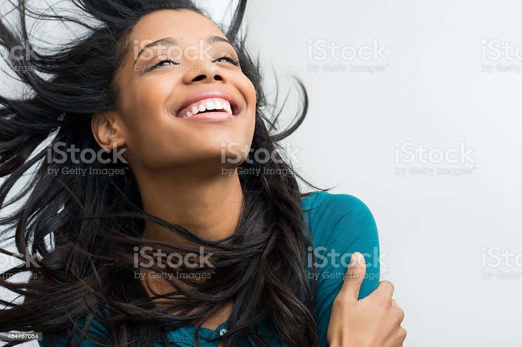 Hispanic lady with long black hair smiling happily stock photo