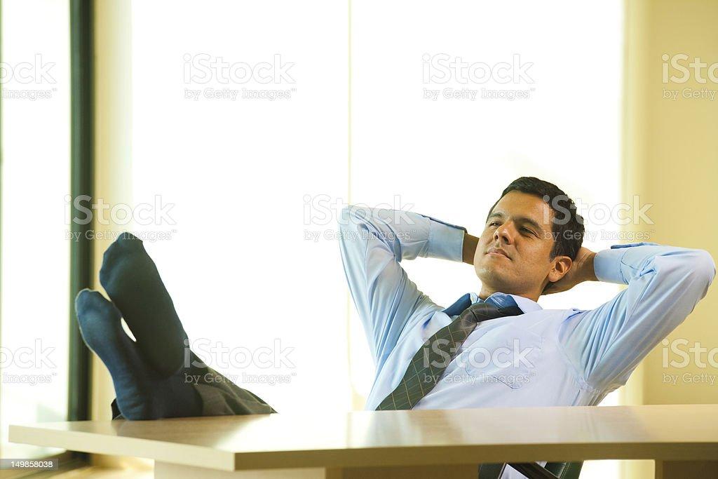 Hispanic Male Hands Behind Head Reclining royalty-free stock photo